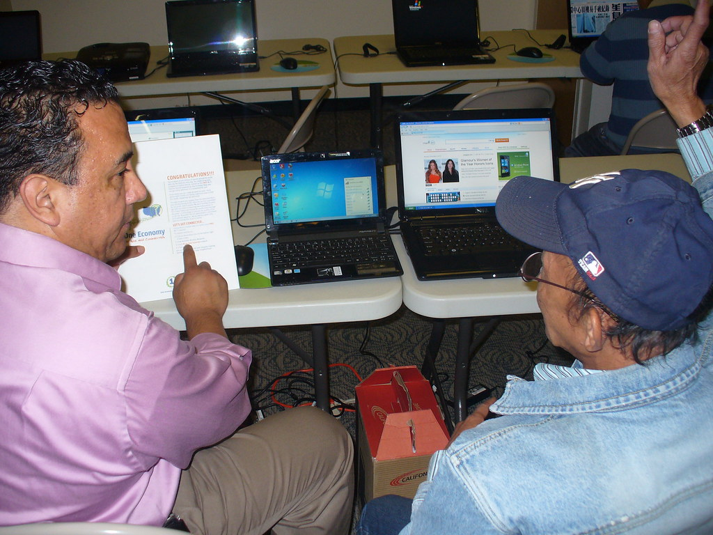 CIO Leo Sosa Working with a resident (explaining how to connect to the network)
