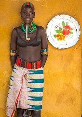 Hamer tribe woman standing at the entrance of a restaurant, Omo valley, Dimeka, Ethiopia (Eric Lafforgue) Tags: adornment adult africa beaded beads beautiful belt candid colorful developingcountry dimeka eastafrica embellishment enamel ethiopia ethiopia0617324 ethiopian ethiopianethnicity female hamar hamer headwear hornofafrica indigenousculture jewel jewelry lookingatcamera multicoloured necklaces omovalley onepersononly onewomanonly plate portrait restaurant southernethiopia traditionalclothing tribal tribe tribeswoman truepeople turmi vertical women yellowbackground et
