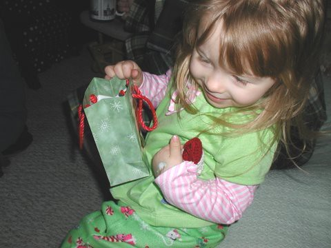Loving her Santa ornament