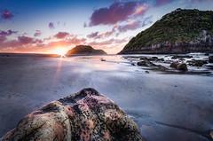 The Rocks of Back Beach #4 (Mark Solly (F-StopNinja)) Tags: sunset sea sky sun beach rock islands twilight sand rocks ray sugar flare loaf hdr newplymouth sigma1020mm backbeach nikond90