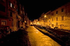 il fiume giallo (gufino (out for awhile)) Tags: water night lights italia fiume ombre giallo luci flowing toscana notte carrara citt noapte oras