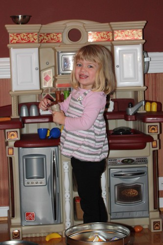 loving her new toy kitchen
