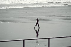 the walk (petitillusion) Tags: winter sea people bw beach portugal water sand atlanticocean cascais carcavelos canon1000d