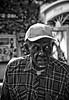 Just walkin' (alan shapiro photography) Tags: street old summer bw man monochrome hat mono character bn africanamerican expressive canonrebel plaid aging 2009 grizzled alanshapiro ashapiro515 canonrebelt1i ©2010alanshapiro alanshapirophotography wwwalanwshapiroblogspotcom ©2010alanshapirophotography