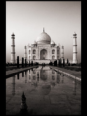 The Classic View (Satyaki Basu) Tags: travel people india reflection water up architecture canon photography eos dr muslim taj mahal tajmahal agra mausoleum dome 1750 tamron bnw minarets pradesh uttar basu mughal mughalarchitecture explored satyaki 450d earthasia gettyimagesmiddleeast
