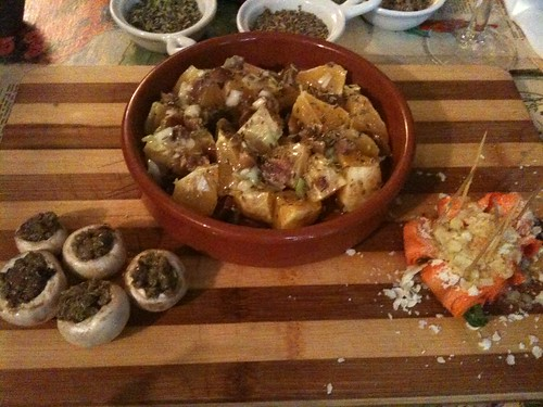 La Tête dans les olives: Orange salad with anchovies, black olives, and onions, mushrooms stuffe d with capers and oregano, mint carrot rolls with ricotta salata