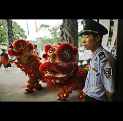 lion stairs . under control - China ( Tatiana Cardeal) Tags: guangzhou china travel red urban men digital asia control chinese structure guangdong reality  tatianacardeal 2009 myth canton liondance  panyu canto  mythreality