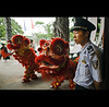 lion stairs . under control - China (© Tatiana Cardeal) Tags: guangzhou china travel red urban men digital asia control chinese structure guangdong reality 中国 tatianacardeal 2009 myth canton liondance 中國 panyu cantão 广州市区 mythreality