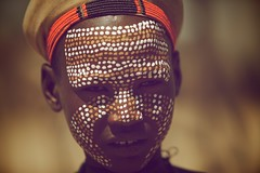 Arbore face art (ingetje tadros) Tags: africa travel portrait orange art face hat portraits eyes desert embroidery african jewelry tribal bodypaint adventure ethiopia facepaint ethnic bodyart 2010 ethiopian omo tribalart arboretribe weytovalley ethtnic