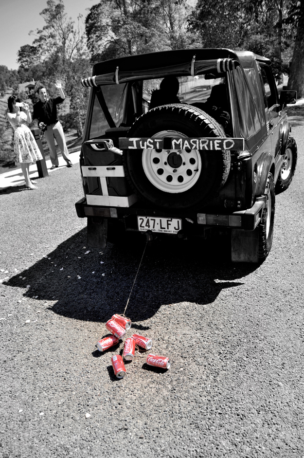 Just married car with red coke cans