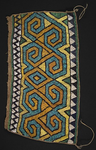 //Bead Panel// from a baby carrier, Basap people, Borneo 19th century, 39 x 20 cm. From the Teo Family collection, Kuching. Photograph by D Dunlop.