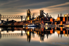 Essar Steel (Billy Wilson Photography) Tags: cloud ontario canada reflection industry water clouds digital canon reflections river boats eos rebel boat industrial pollution ugly shack xs soo northern hdr highdynamicrange saultstemarie northernontario algoma blastfurnace cs4 steelmill cokeovens tonemapped photomatixpro billywilson photoshopcs4 orebridge skyatmosphere