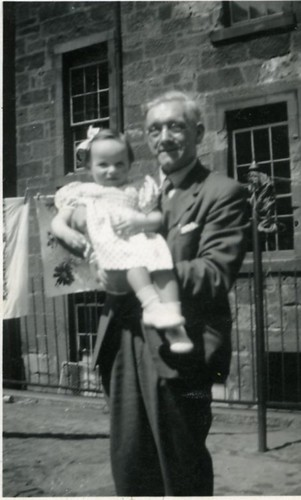 Alex Sandy Gibson with grandchild backcourt 138 Duke Street 1952