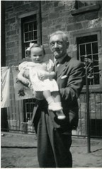 Image titled Alex Sandy Gibson with grandchild backcourt 138 Duke Street 1952