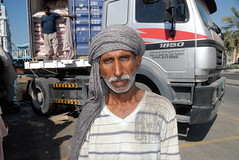 TRUCKING IN DUBAI (Claude  BARUTEL) Tags: pakistan portrait dubai united transport emirates arab sharjah trucking coolie