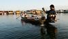 Fishing (gurbir singh brar) Tags: morning india net water dawn boat early fishing nikon focus couple lifestyle kashmir srinagar nikkor hardwork 2010 teamwork diligence occupation dallake nikond700 2470mmf28g gurbirsinghbrar