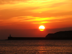 Sunset 15th April 2010 (seamaidengems) Tags: uk lighthouse sussex harbour newhaven seaford bythesea volcanicsunset