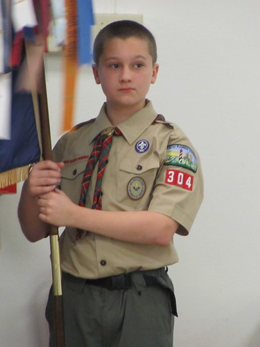 Last time bearing the pack flag as a Cub Scout - 'cause he's a Boy Scout now!