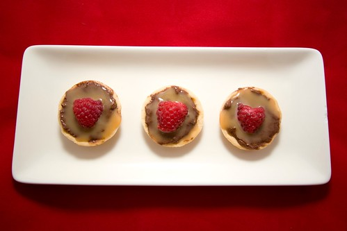 Teeny Tiny Dark Chocolate Cheesecakes with Cajeta and Raspberries
