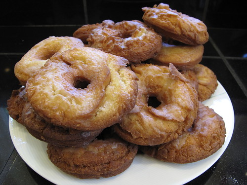 a pile of homemade glazed apple cider donuts