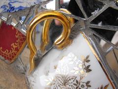 (Sok Tahu) Tags: uk newcastle mirror nikon pretty brokenglass kitsch teacup shards newcastleupontyne mirrorframe nikond60 quaysidemarket