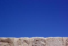 liquid liquid:out (visualpanic) Tags: blue summer sky españa azul wall composition pared outdoor cel minimal bleu ciel cielo verano blau 2009 paret agost zamora estiu espanya composició