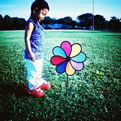 pinwheel baby (Jay Panelomo) Tags: people baby film analog 35mm square iso100 kid lomo xpro crossprocess ct slide diana squareformat analogue zia agfa precisa panelomo dianamini