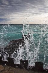 Dancing Water (ETCphoto) Tags: sky clouds waves crash michigan lakemichigan foam splash breakwall frankfort 9567 ptbetsielighthouse
