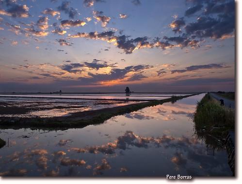 amanecer con reflejos....y fotógrafos