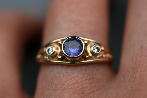It is very similar to my wedding ring except it is a sapphire flanked by