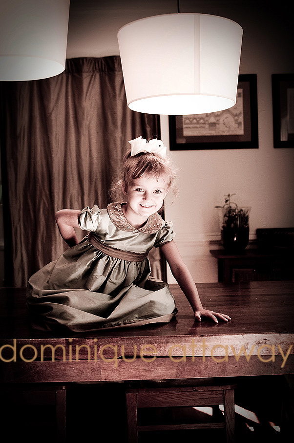 little girl dressed up on dining room table