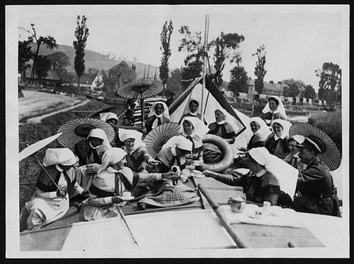 Red Cross Barge Nurses during a quiet spell in France take tea in a barge