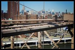 The age of steel (reflexer) Tags: city nyc newyorkcity bridge urban usa ny newyork silhouette skyline geotagged manhattan steel lowereastside midtown stadt brooklynbridge eastriver empirestatebuilding chryslerbuilding brcke stahl geo:lon=73996975 geo:lat=4070621