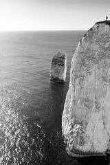World's Edge (Old Harry Rocks), Dorset (flatworldsedge) Tags: sea england cliff sun scale silhouette reflections chalk rocks waves sparkle ripples nationaltrust midday exposed purbeck studland oldharry