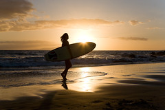 surfer sunset (*michael sweet*) Tags: travel sunset sea summer vacation woman sun holiday beach beautiful silhouette sport female sunrise outdoors island happy one hawaii coast healthy surf getaway surfer maui bikini surfboard tropical tropic sunburst activity carefree fit active