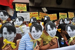 Activists Hold Up Cut-Out Images of Aung San Suu Kyi