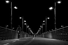 Night time (Daniel Nebreda Lucea) Tags: night noche city ciudad street calle bridge puente pattern patron lines perspective perspectiva bicycle bicicleta cyclist ciclista sport verano lights luces light luz shadows sombras sky cielo motion movimiento speed velocidad urban urbano urbana black white blanco negro monochrome monocromatico bw long exposure larga exposicion canon 50mm 60d travel viajar texure textura zaragoza spain españa europe europa architecture arqutectura building construccion structure estructura