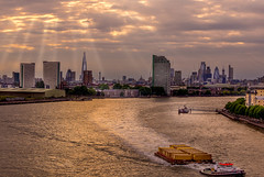 London sunbeams (Geoff Eccles) Tags: sunset eveninglight boats workingfarm tug beamsoflight riverthames tugboat london dramaticsky londonskyline skyscrapers architecture sunbeam skyline ships barge