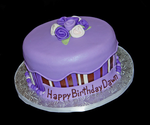 purple and brown birthday day cake