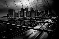 eastbound ([Adam Baker]) Tags: new york city nyc longexposure bridge bw white ny black blur cars water speed canon traffic suspension cloudy manhattan monotone rush brooklynbridge eastriver gotham blending 24105l adambaker 5dmarkii
