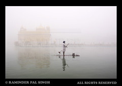 Heavenly Fog (Raminder Pal Singh) Tags: india weather fog canon gold boat god religion sikhs turban punjab float coldweather reflexions amritsar goldentemple afc pca bestofflickr foggymorning morningtime harimandirsahib 50d darbarsahib raminder inspiringimages fogandrain sarowar canon50d harimandarsahib shotinthemorning heavenlyabode flickrsbest raminderpalsingh onacoldmorning siftidaghar bestimages sikhsewadar fogatthegoldentemple goldentemplepicture sewadaratthegoldentemple boatatgoldentemple cleaningthesarowar goldentemplethroughfog shoton50d sikhatthegoldentemple wonderfulimages