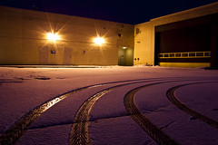 Mall (Billy Wilson Photography) Tags: longexposure winter snow ontario canada cold building ice night digital canon mall dark eos rebel lights lowlight december garage tripod xs soo northern saultstemarie tiretracks northernontario algoma billywilson diffractionstars
