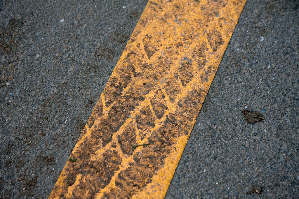 Close-up of SUV tire track on rubber band