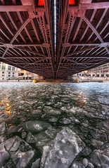 On the rocks (kern.justin) Tags: city bridge winter sunset red urban orange snow chicago cold green texture ice water metal river photography frozen photo nikon downtown photographer perspective january freezing wideangle michiganavenue chicagoriver hdr waterway underthebridge watersurface chicagoist michiganavenuebridge photomatix hdrphotography icechunks d700 iceshards nikond700 nikon1424mmf28 kernjustin