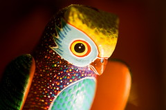 An owl lit by the light of wisdom (La Branaro) Tags: macro film glass 35mm lens 50mm 1 carved focus soft folkart hand kodak brothers bokeh painted olympus carving depthoffield made mexican master homemade 400 figure owl wise shallow om figurine technicolor portra vc zuiko om1 castillo magnifying oaxacan alebrije carvers portravc magnifyingglassmacro