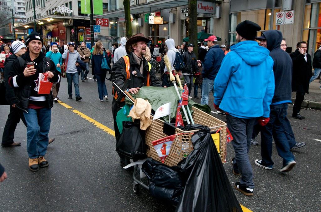 Homeless Man Heckling Small Group of Protestors