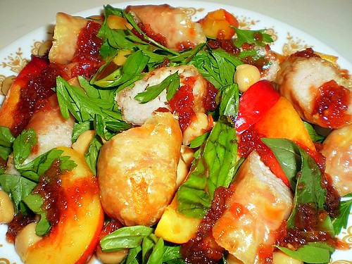 Chicken sausages with nectarines, chickpeas and redcurrant sauce