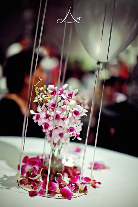 Beautiful tropical orchids decorating the tables at dinner reception