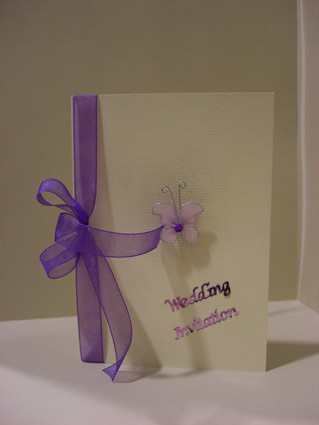 small wedding invitation with ribbon
