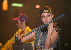 Mean Fiddler (peterkelly) Tags: musician music woman ontario canada streets festival digital downtown guelph center canadian violin bow northamerica fiddle fiddler 2010 kytami hedband sleemancentre delhi2dublin hillsideinside